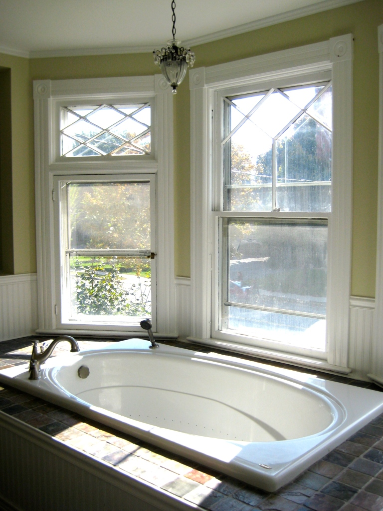 A small, oddly placed bedroom converted to a bath for the master-suite.
