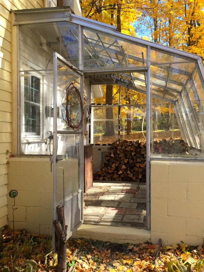 This year I decided to put the old attached greenhouse to use storing wood. it's too shaded now and no longer heated for starting and growing seedlings. Plus it needs some new glass and foundation repairs. But I am hoping it will serve it's new purpose keeping firewood (and me) dry and snow-free.